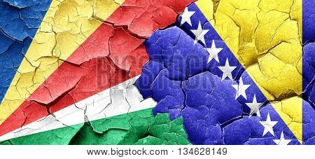 seychelles flag with Bosnia and Herzegovina flag on a grunge cra poster