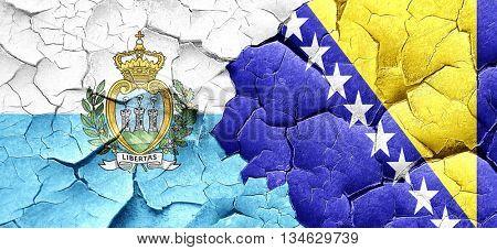 san marino flag with Bosnia and Herzegovina flag on a grunge cra poster
