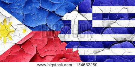 Philippines flag with Greece flag on a grunge cracked wall