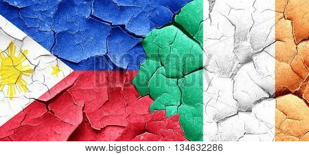 Philippines flag with Ireland flag on a grunge cracked wall