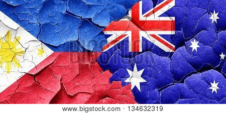 Philippines flag with Australia flag on a grunge cracked wall
