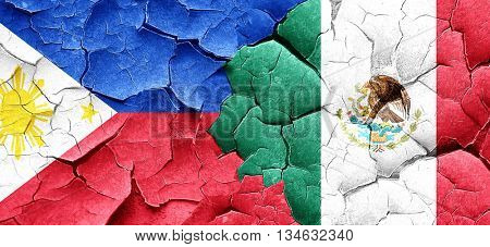 Philippines flag with Mexico flag on a grunge cracked wall