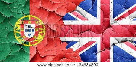 Portugal flag with Great Britain flag on a grunge cracked wall