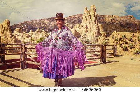 LA PAZ, BOLIVIA - MARCH 31, 2013: An unidentified woman in traditional colourful clothes in Valle de la Luna - touristic attraction in La Paz, Bolivia.