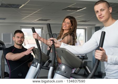 Group Of People Running On Treadmills In Gym