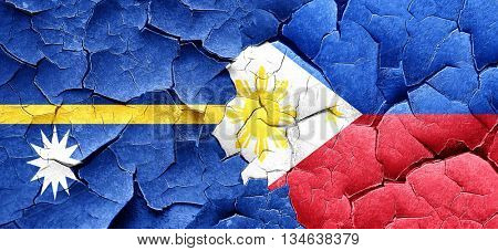 Nauru flag with Philippines flag on a grunge cracked wall