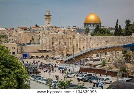 Jerusalem, Israel - May 9, 2016: Prayers at the Western Wall and the Dome of the Rock in the old city of Jerusalem Israel.