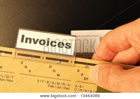 invoice or invoices concept with business folder in office showing paperwork poster