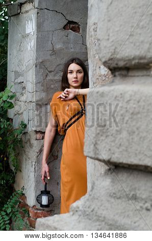 Beautiful girl in a long boho dress posing in the street
