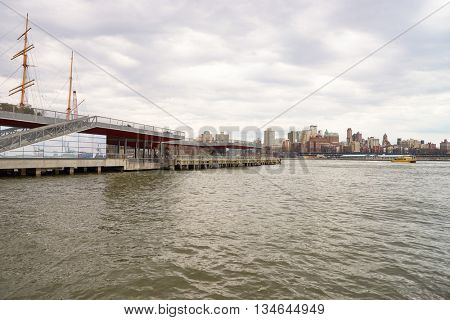 NEW YORK - MARCH 17, 2016: view of Pier 15 at daytime. Pier 15 is located east of South Street and FDR Drive in Lower Manhattan, New York City.