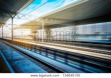 high-speed train at the railway station,motion blurred,tianjin china.