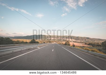 Paved Two Lane Road Crossing Mountains And Forest. Panoramic View From Car Mounted Camera. Summer Ad