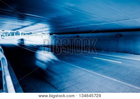 motion blurred car in tunnel.Chinese characters on road are all traffic roadmarking.