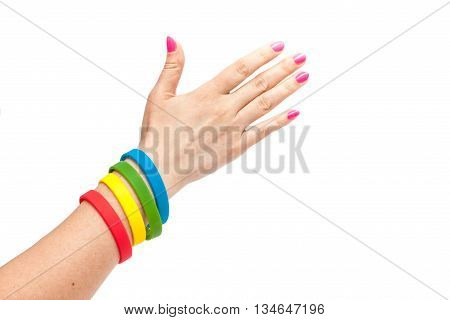 Colored latex bracelet on the arm on White Background. Multicolor