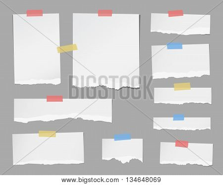 Pieces of ripped white note paper are stuck with masking tapes on gray background.