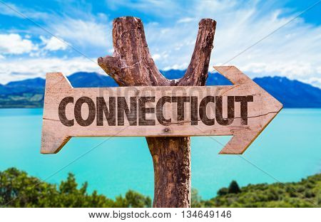 Connecticut wooden sign with landscape background
