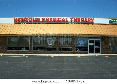 SHOREWOOD, ILLINOIS / UNITED STATES - AUGUST 21, 2015: Newsome Physical Therapy offers physical therapy services in a Shorewood strip mall.