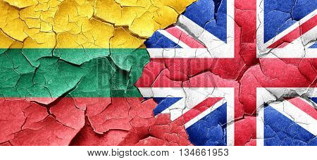 Lithuania flag with Great Britain flag on a grunge cracked wall