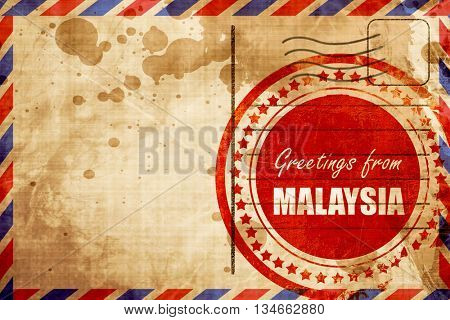 Greetings from malaysia, red grunge stamp on an airmail backgrou