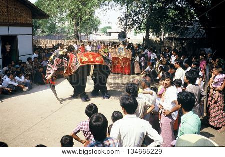 PAGAN / MYANMAR - CIRCA 1987: Two people in an elephant costume put on a show for the people of Pagan.