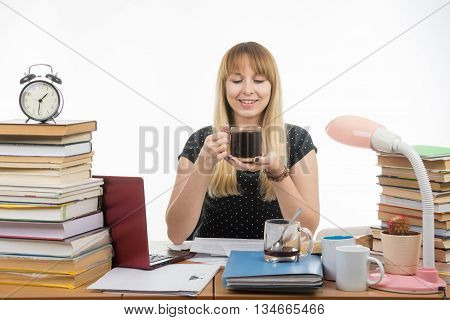 Girl Student Happily Looks At A Glass Of Coffee