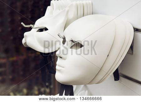 White Venetian masks on the wall, Venice, Italy