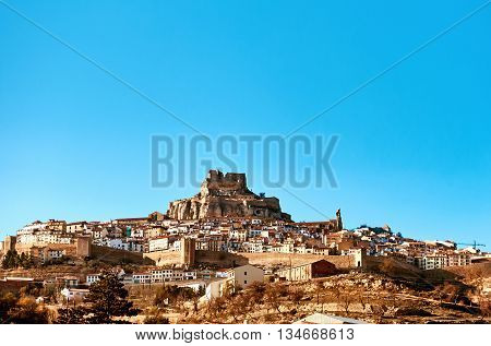 Morella skyline. Morella is an ancient gothic city located on a hill-top in the province of Castellon Valencian Community Spain. Morella is in the heart of the historic region of Meastrazgo and it is listed as one of the most beautiful towns in Spain