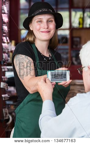 Waitress Holding Smart Phone With Coupon Code