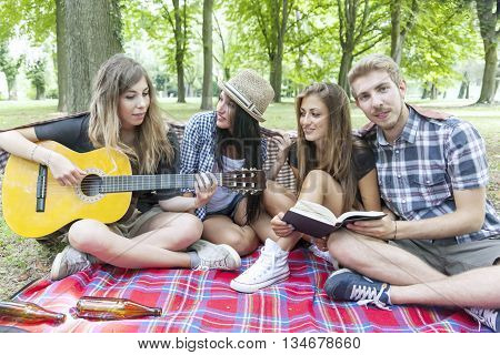 Young Adults Have Fun With Guitar At The Campground