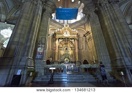 BRAGA, PORTUGAL - September 22, 2015: The main altar and a person showing reverence and adoration for Our Lady in the Sanctuary of Sameiro on September 22, 2015 in Braga, Portugal