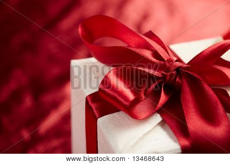 Beautiful gift box on the red background
