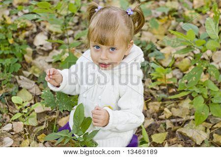 adorable little girl in park