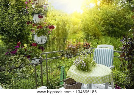 Summer Terrace or Balcony with small Table, Chair and Flowers