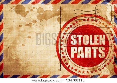 stolen parts, red grunge stamp on an airmail background