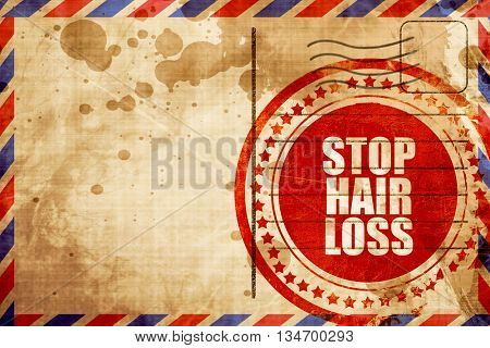 stop hair loss, red grunge stamp on an airmail background