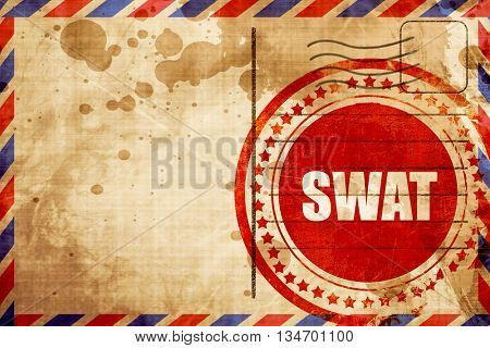 swat, red grunge stamp on an airmail background