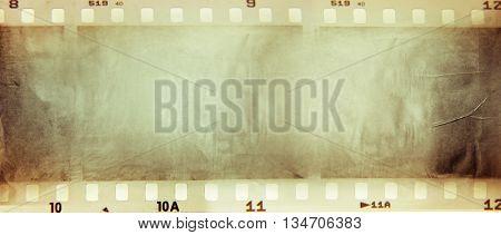 Film negative frames on brown paper