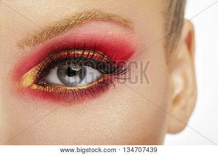 Make Up Beauty Close Up. Eye With Red And Gold Make Up