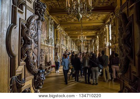 FONTAINBLEAU, FRANCE - MAY 16, 2015: Gallery Francis I is a combination of the amazing beauty of carved wood with a light gilding and painting Italian masters.