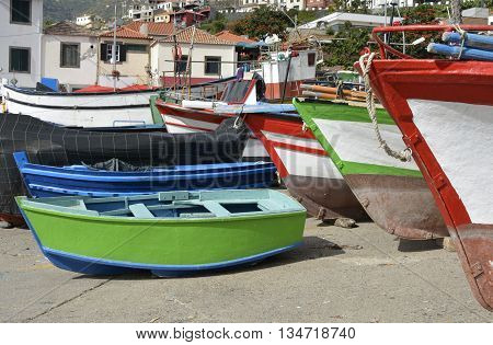 Fishing boats drawn up on beach and slipway at Camara de Lobos in Madeira Portugal