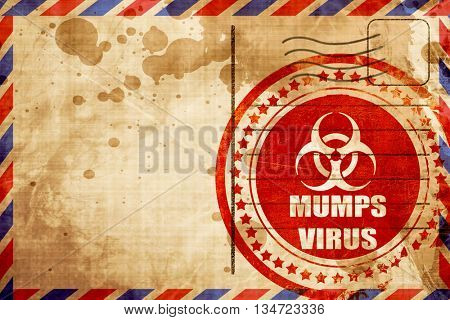Mumps virus concept background, red grunge stamp on an airmail b