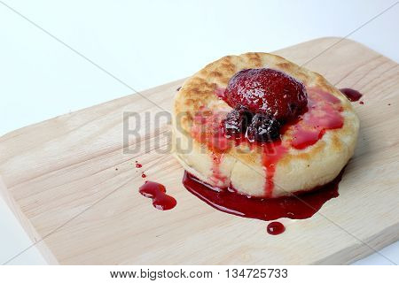English Crumpets & Berry Topping On Wood Board Isolate On White Background