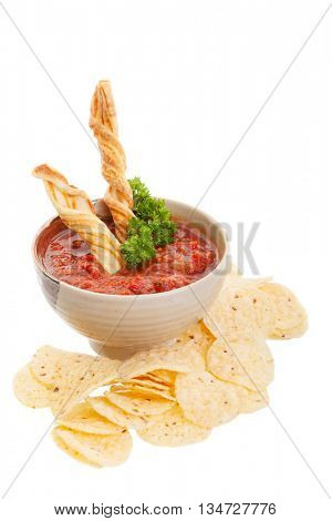 Nachos chips with fresh homemade salsa isolated on white.