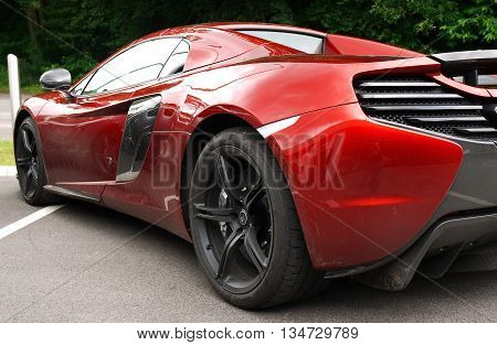 ASCOT, UK - JUNE 16, 2016: McLaren 570 supercar which is the cheapest super car supplied by McLaren picture taken from the street