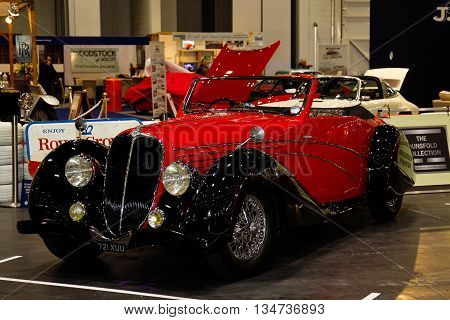 LONDON - JANUARY 10: An immaculate vintage Delahaye motorcar is put on public display at the inaugural London Classic Car Show event held at the Excel arena on January 10, 2015 in London