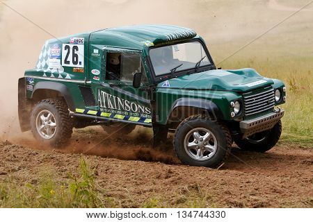 WULSTAN, UK - JULY 21: An unnamed driver reaches the outer limit of the course before turning back into the wood sections during the AWDC UK Brit Part Comp Safari competition on July 21, 2013 in Wulstan.