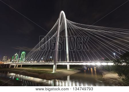 DALLAS USA - APR 8: The Margaret Hunt Bridge over the Trinity River in Dallas illuminated at night. April 8 2016 in Dallas Texas USA