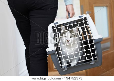 Woman Taking Pet Cat To Vet In Carrier