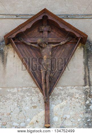 Wooden sculpture depicting Jesus Christ on the cross
