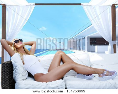 woman relaxing in a cabana. 3d rendering